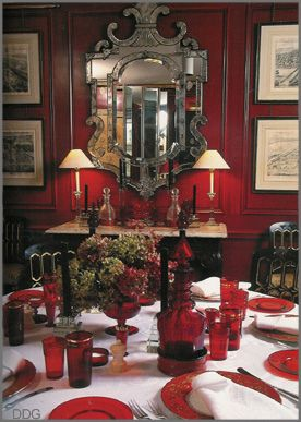 love this red dining rooms--black chairs, Venetian mirror ...