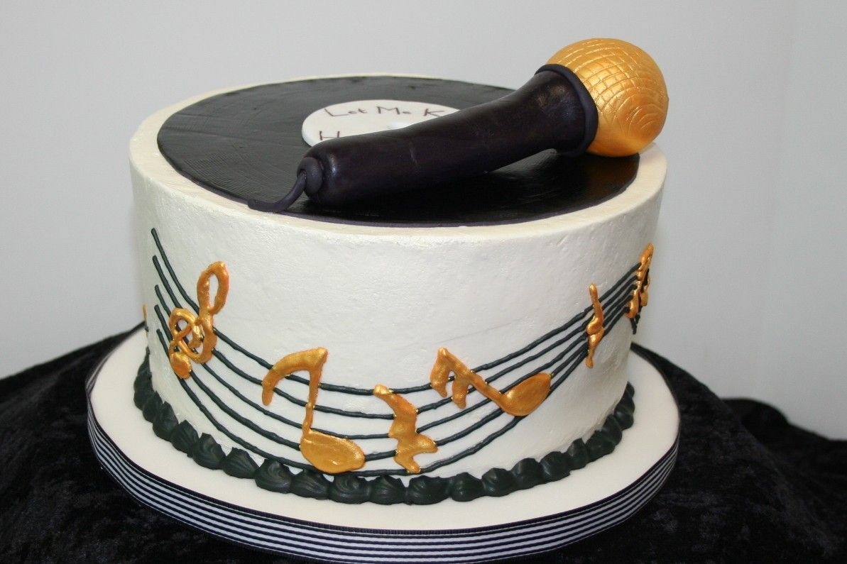 """Record Album & Microphone - 8"""" Chocolate/White checkerboard cake with swiss buttercream frosting. Could have done the sides better, next time will cover in fondant and bring the music staff all the way to the top."""