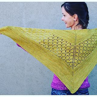 Peacock Lake is a timeless Triangle shawl with leaf lace and garter sections.