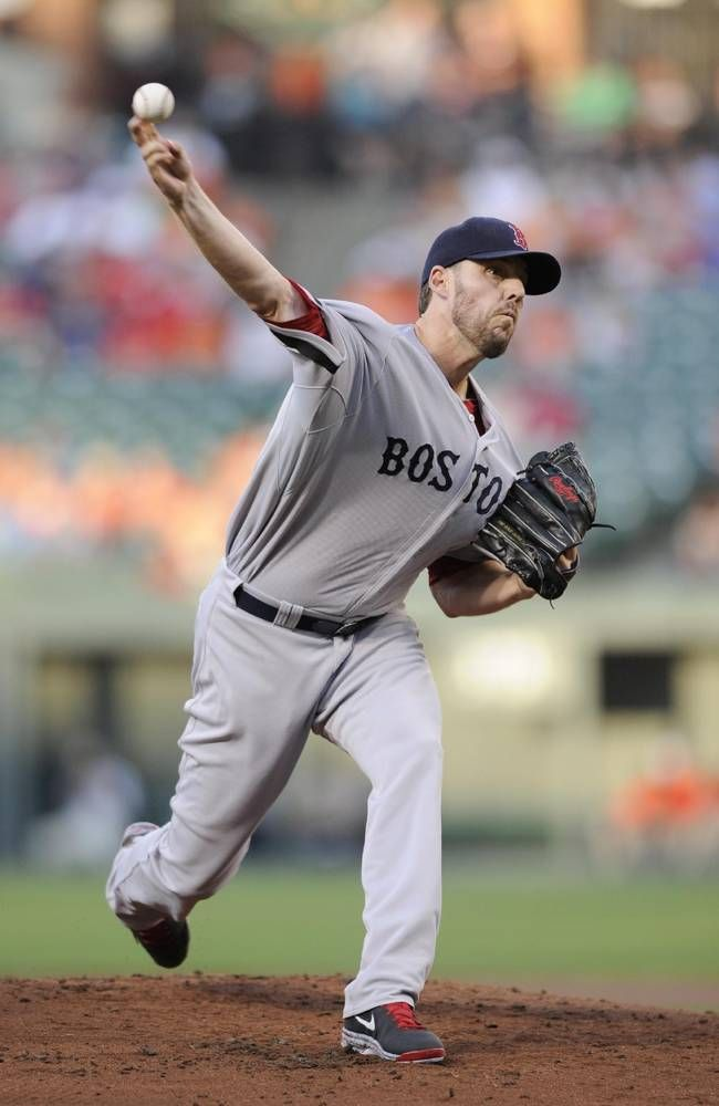 Boston Red Sox starting pitcher John Lackey delivers