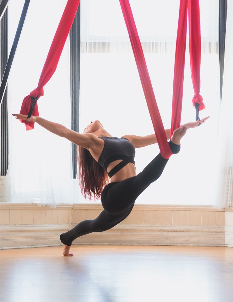 aerial fabric acrobatics has been providing the finest in aerial silks hardware and aerial yoga equipment since buy your silk fabric today  dramatic splits stretch using the flying trapeze yoga hammock      rh   pinterest