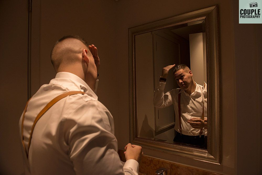 Lenny gels his hair for the wedding.  Real Wedding at Druids Glen, photographed by Couple Photography http://www.couple.ie/2016/08/rachel-lenny-druids-glen/