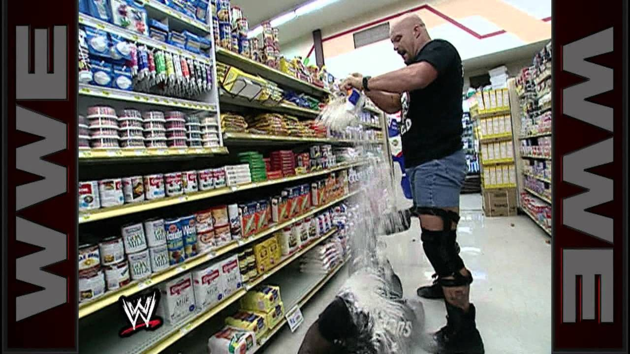 """""""Stone Cold"""" Steve Austin and Booker T brawl it out inside"""