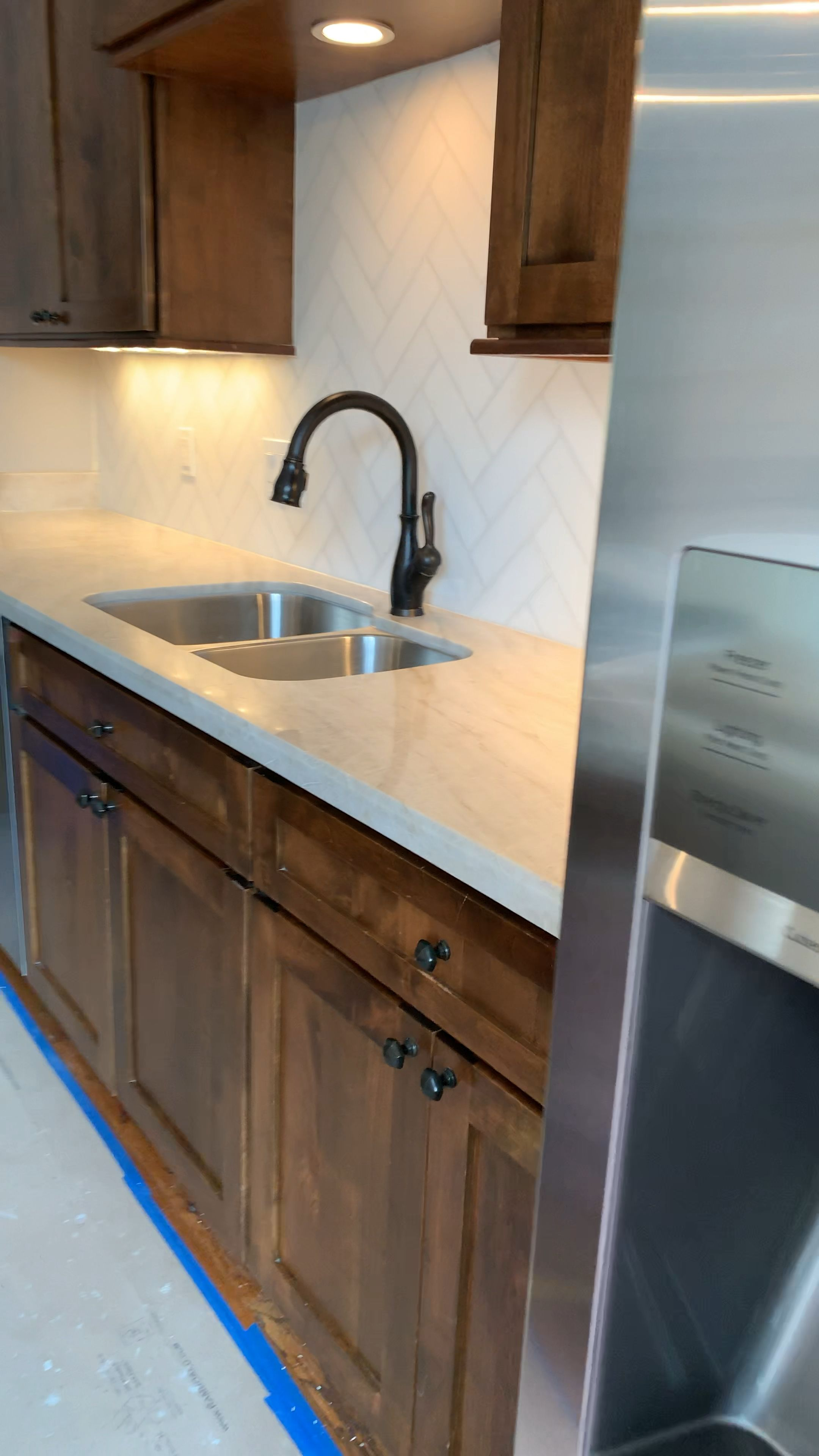 Photo of Herringbone kitchen backsplash