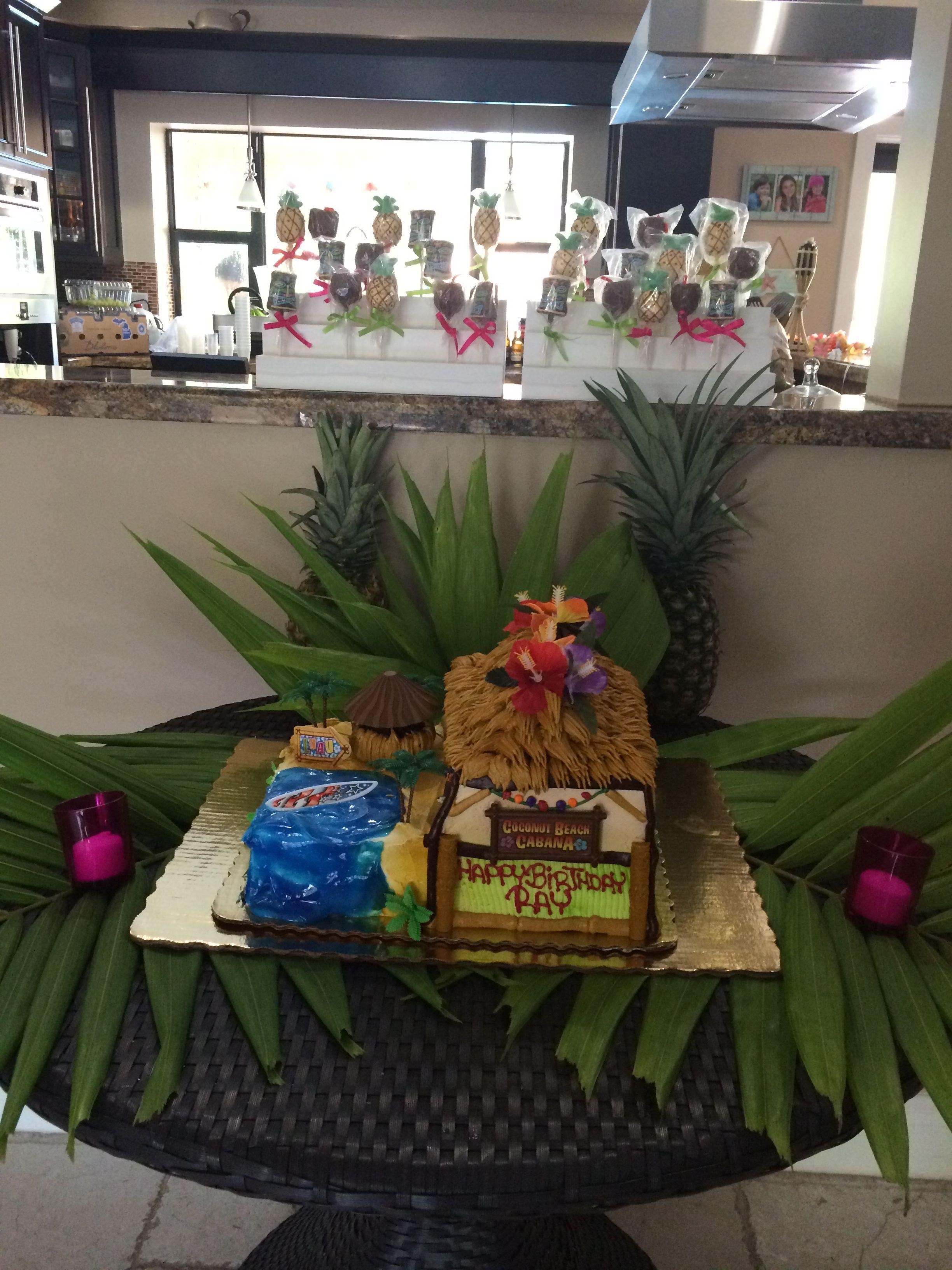 Cabana cake and matching cake pops cabana cake table