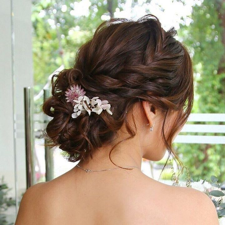 Beautiful loose braid and low updo hairstyle for romantic brides