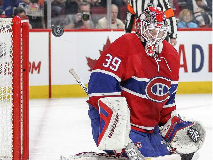 Montreal Canadiens goalie Mike Condon keeps his eyes on a rebound after making a save during second period of National Hockey League game against the Columbus Blue Jackets in Montreal Tuesday December 1, 2015.