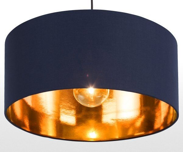 The Huge Pendant Shade In Navy And Copper Maximizes The