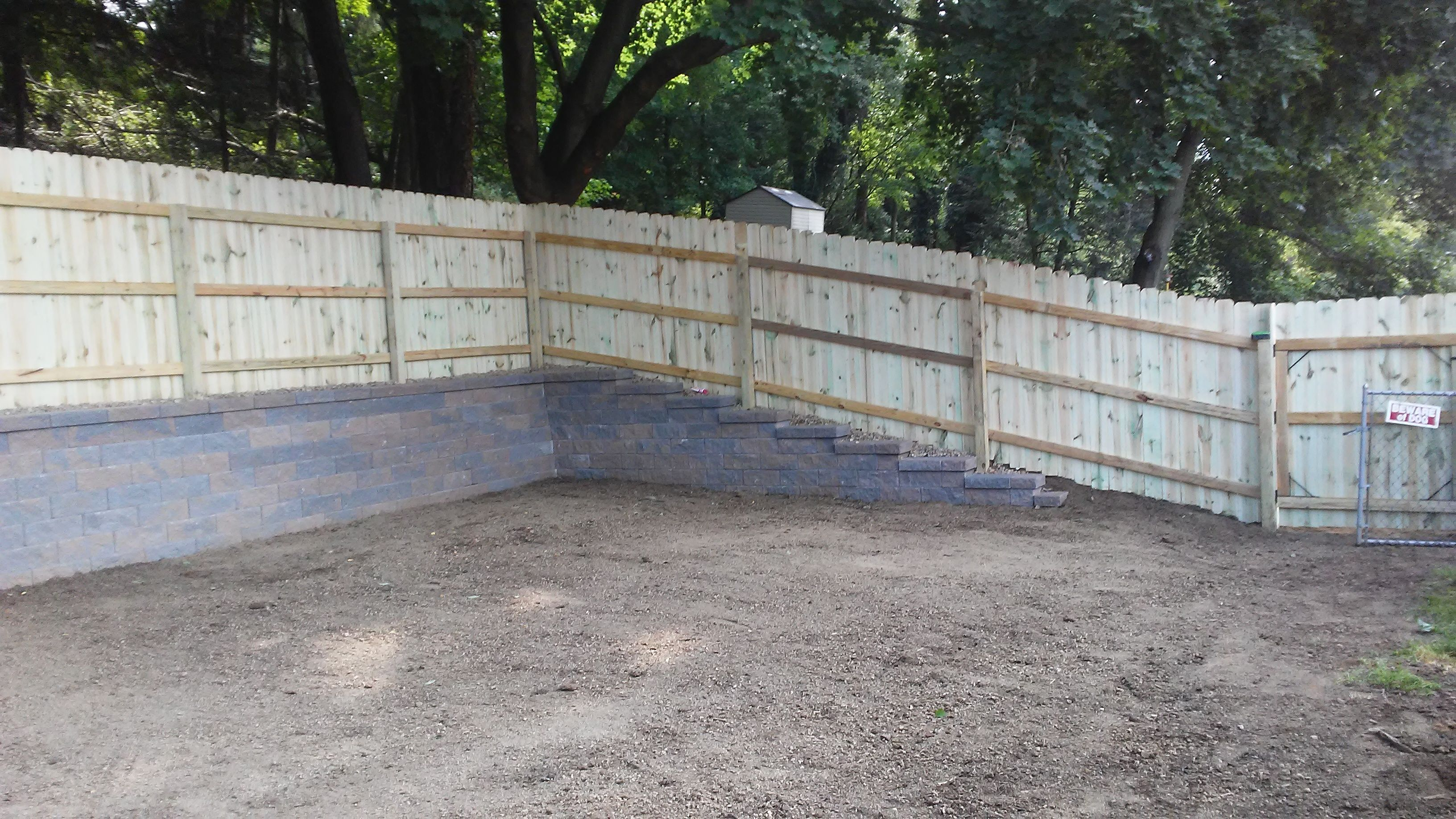 Yard leveled out, Versa-Lok retaining wall and privacy ...