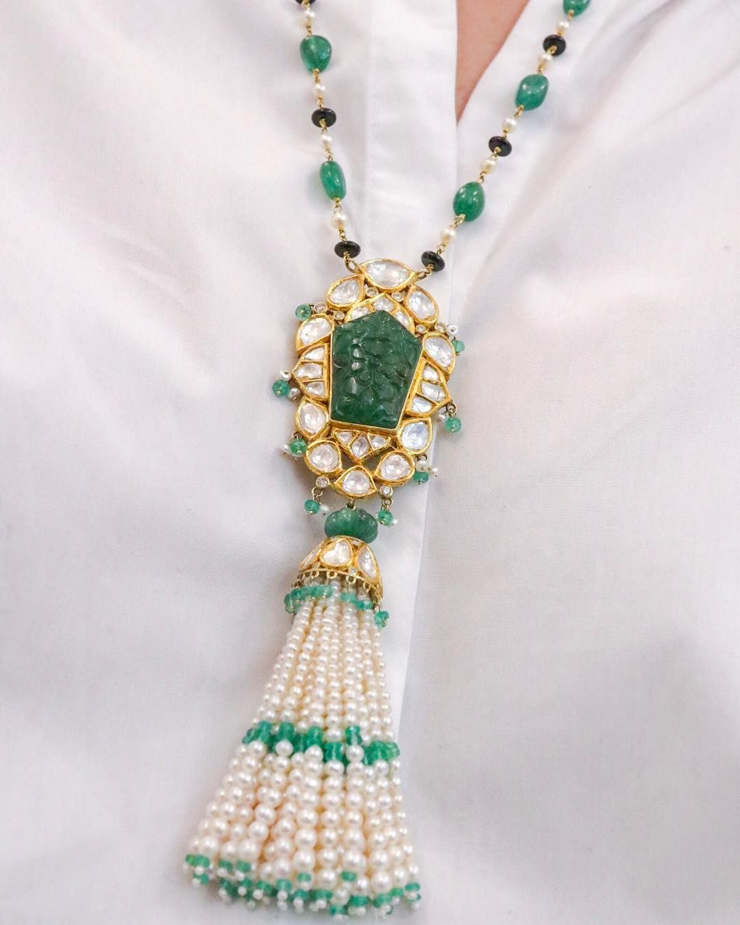 This elegant necklace by Jewels of Jaipur, blends two iconic