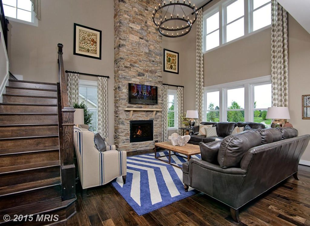 Traditional Living Room with stone fireplace, High ceiling ...