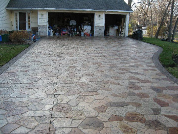 Canyon Stone Driveway With Acid Stained Stones And Exposed Aggregate