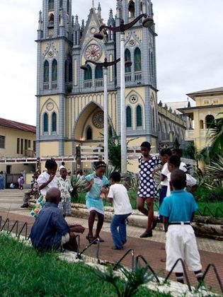 A cathedral courtyard doubles as a playground in Malabo, capital of Equatorial Guinea.  Photograph by AP Photo/Christine Nesbitt