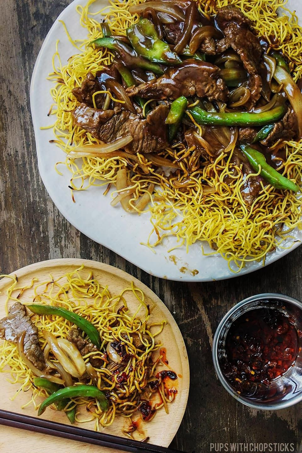 Crispy Cantonese Beef Chow Mein Crispy Cantonese beef chow mein recipe loaded with saucy beef, peppers and onions on top. A very common takeout dish that's delicious and easy to re-create right in the comfort of your home!