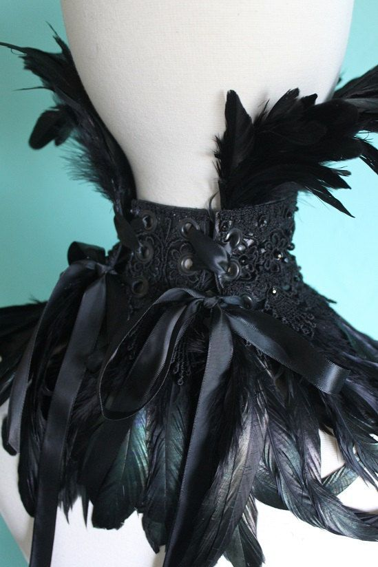 *To order *  Dramatic and elegant. Black leather and lace collar with beautiful fans of black coque feathers that drape across the chest and fan around the face. The collar is decorated Swarovski crystals and glass jet beads. The collar closes at the back in a double corset style with eyelets and ribbon, so it can be adjusted for different sizes. The collar stands about 2.5 high and the coque feathers measure 5 around the face and approx 7 around the neck.  *Please note I use only recycled…