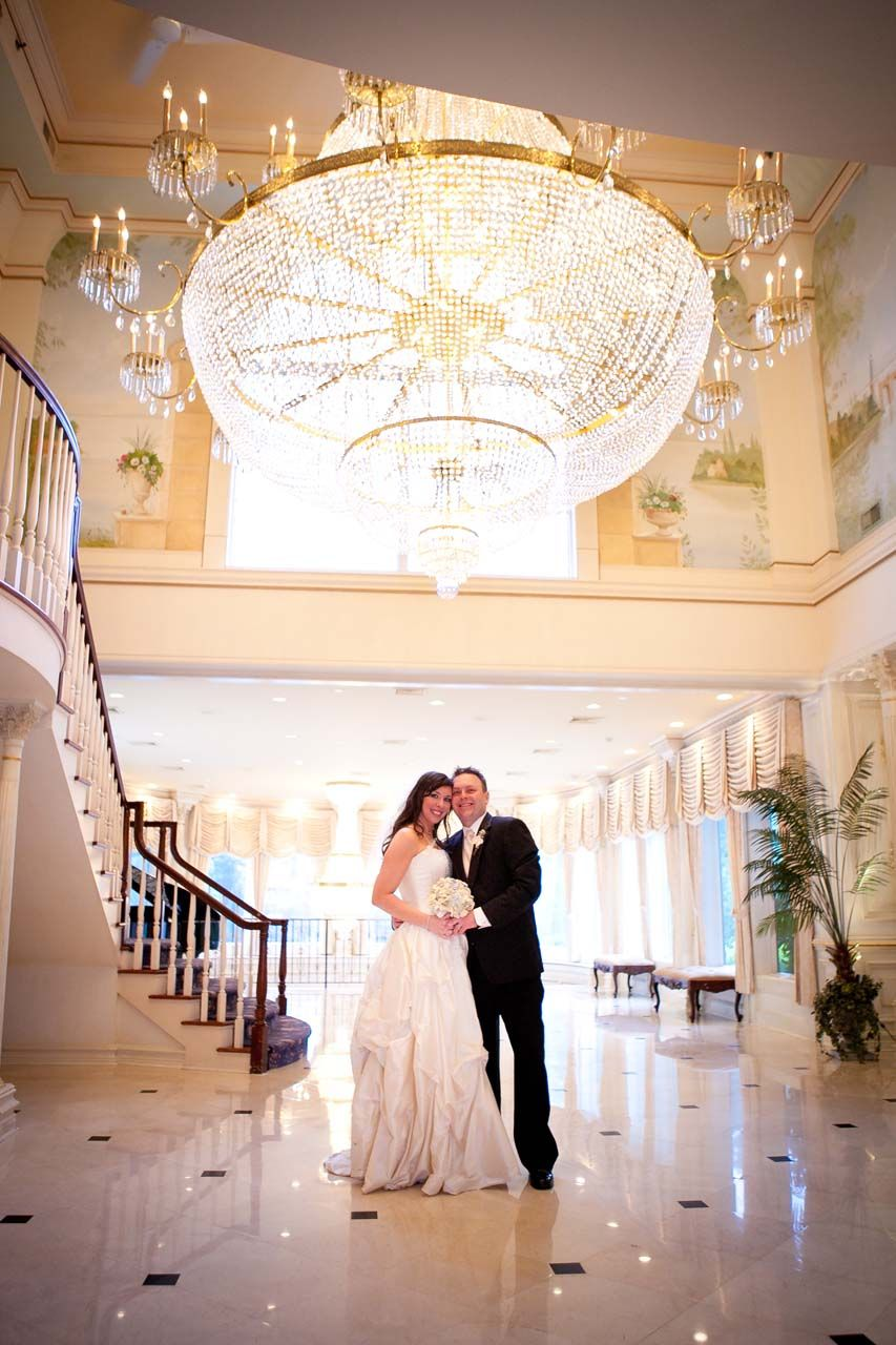 Estate weddings in nj - Whimsical Diy Wedding Bride And Groom Pose In The Entrance Hall Of The Estate