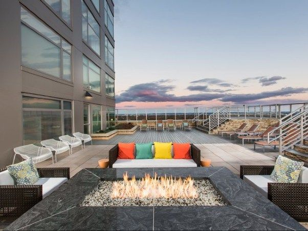 Stunning Rooftop Fire Pit Sign Us Up View At Liberty Center Apartments Arlington Va 22203 Apartme Amazing Apartments Cool Apartments Apartments For Rent