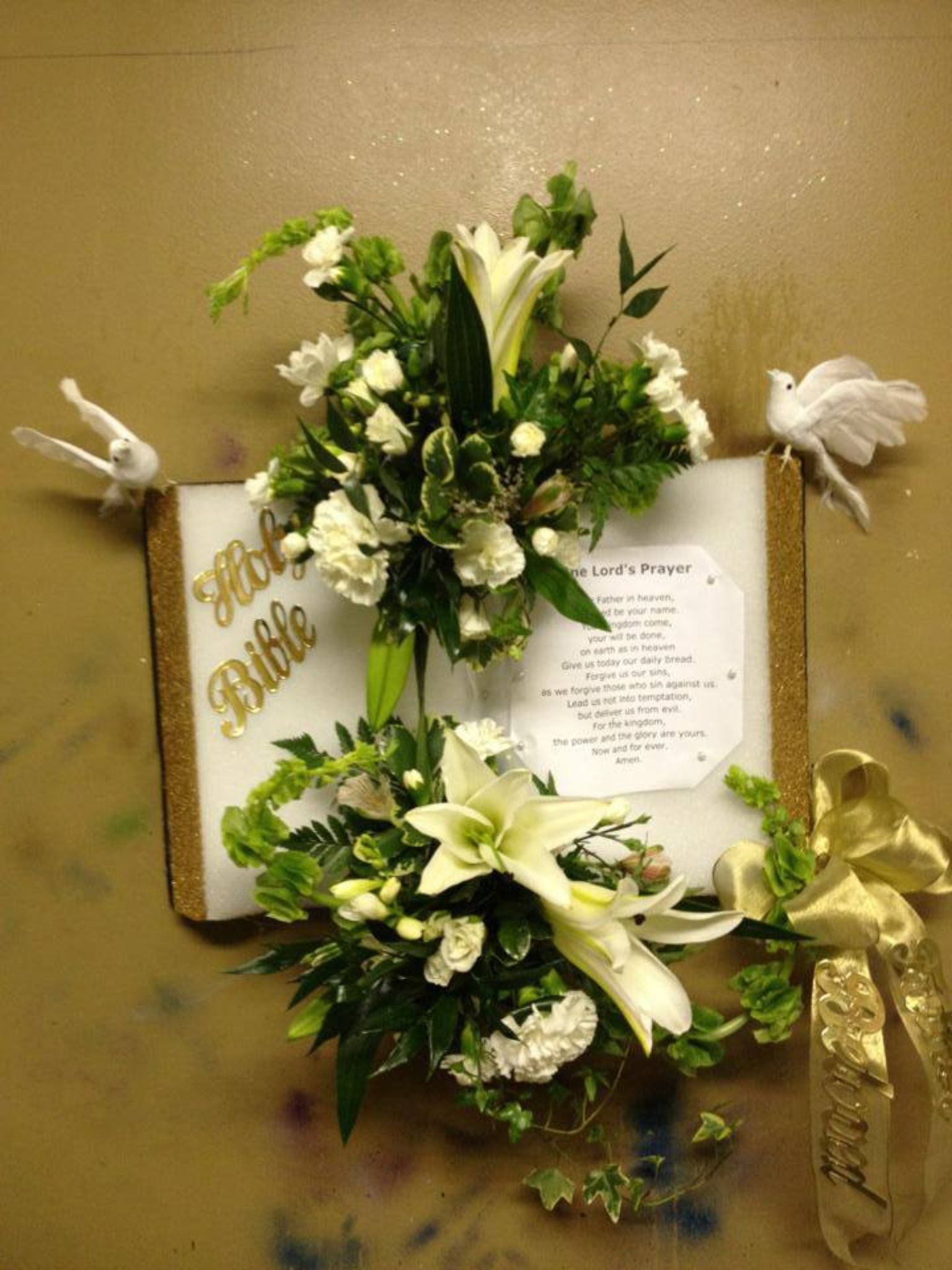 Bible with flowers Funeral floral arrangements