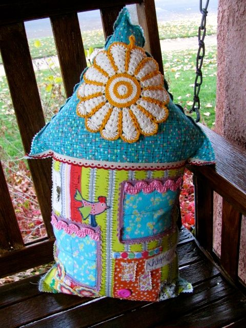 Pillow made from vintage crochet hot pad, vintage trim and some new fabric.   Cozy on the porch swing my parents had when I was a child.