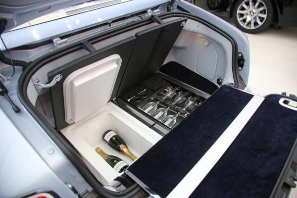 The trunk of a Rolls-Royce Phantom Drophead Coupe, with built in cooler and glass holder | Rolls royce phantom drophead, Rolls royce, Super cars