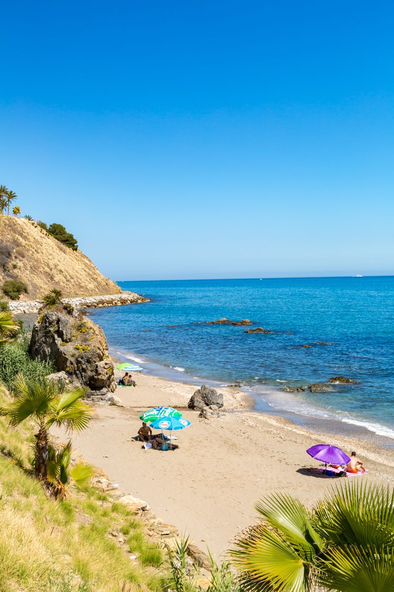 If you're after a bit of peace and tranquillity, park yourself down on this quiet secluded beach dotted with mysterious coves and craggy rocks. It has a more windswept feel than the busier beaches in Benalmadena. It doesn't have many facilities, but it does have disabled access.