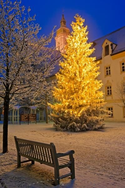 Photo of a beautiful scene of a brightly lit christmas tree at night, Freising, Bavaria, Germany.