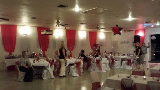 White and red tablecloth rolls from the restaurant store. Ceiling to floor to cover walls. Great way to hide pictures.