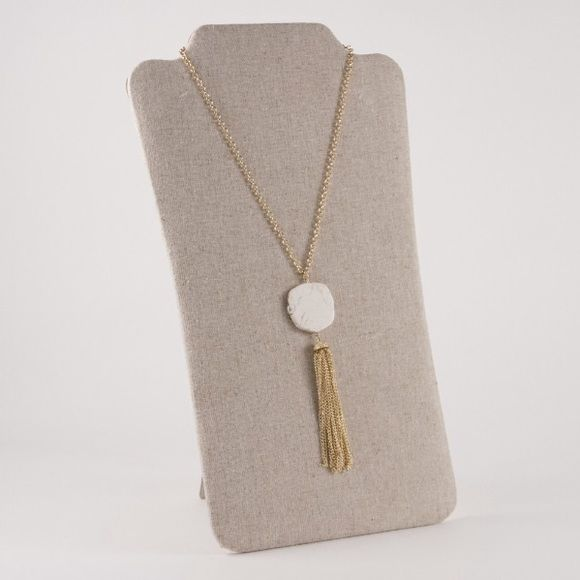"""Stone Tassel Necklace in Cream - NWOT Stone Tassel Necklace in Cream - NWOT. Chain measures approximately 32"""" long with a 3"""" extender. Stone and tassel measures approximately 5"""" long. Color of stone may vary. No trades, no PayPal.❗️I have 5 available, so please let me know when you're ready to purchase and I'll create a separate listing.❗️ Jewelry Necklaces"""