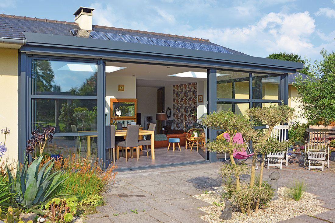 Extension de maison véranda avec un coulissant 4 vantaux au ...