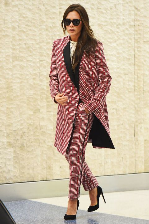 Who: Victoria Beckham What: A Bold Summer Suit Why: The designer makes a serious entrance at the airport in a printed suit, complete with long jacket for added drama. Get the look now: Victoria Beckham jacket, $3,800, victoriabeckham.com.