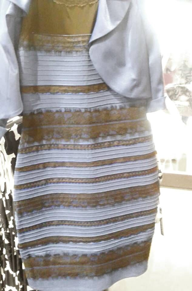 Blue and black gold and white dress trick