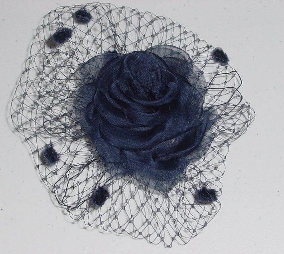 Exquisite Hand cut and hand pressed navy blue silk organza fabric petals are hand assembled into this lovely style. The flower center has vintage pearl peps.This style is accented with French veiling. Assembled on an alligator clip for easy secure hairdo placement. This piece is entirely handmade in my studio. Made to Order ----Ships in 2-3 weeks    hp-40    Before purchase please read posted shop policies here http://www.etsy.com/shop/AnnLeslie/policy    Please check...