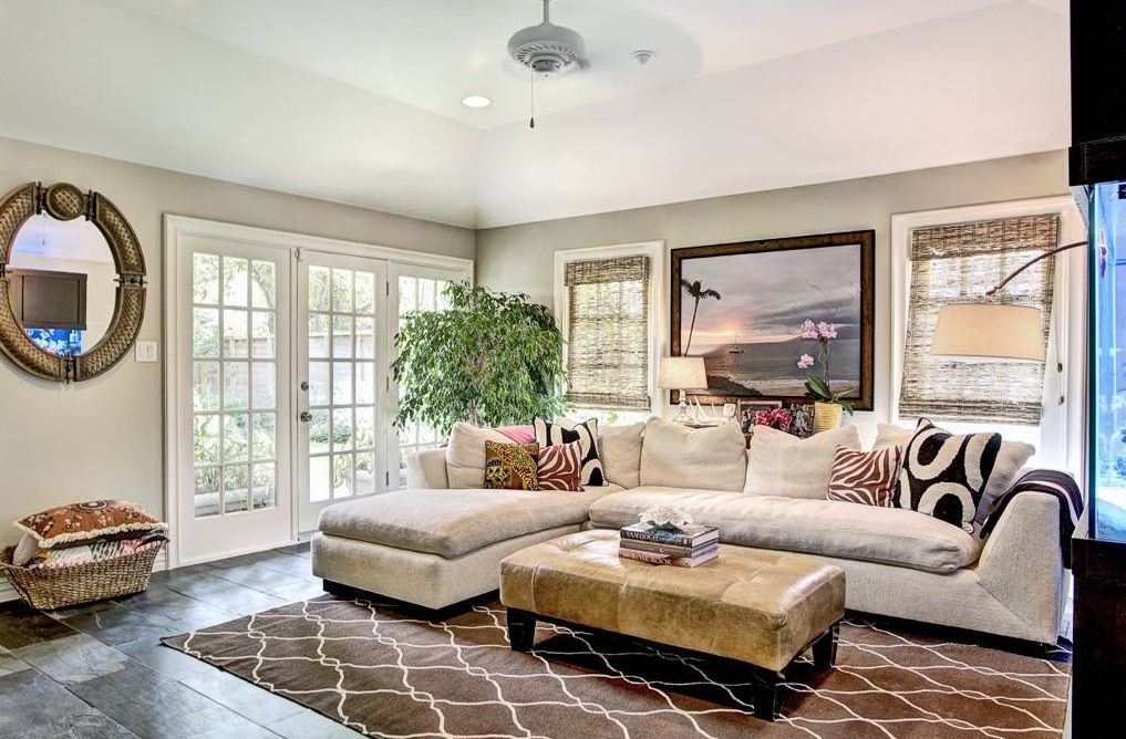 family+room+(17'+x+15')+is+accented+by+a+vaulted+ceiling,+French+doors+to+the+back+deck+&+gardens,+energy+efficient+windows,+slate+floors,+built-in+bookcase+(east+wall)+++cased+openings+to+living+room+and+the+kitchen.jpg (1017×668)