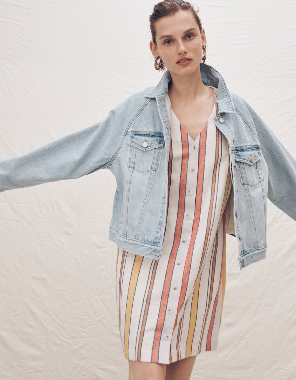 c0d22cceb36a4 madewell raglan oversized jean jacket worn with button-front easy dress.