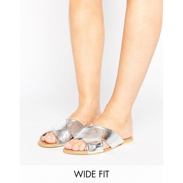 ASOS FLORIST Wide Fit Leather Cross Strap Sliders ($27) ❤ liked on Polyvore featuring shoes, sandals, silver, metallic sandals, wide strap sandals, leather sandals, leather slip on sandals and slip on shoes