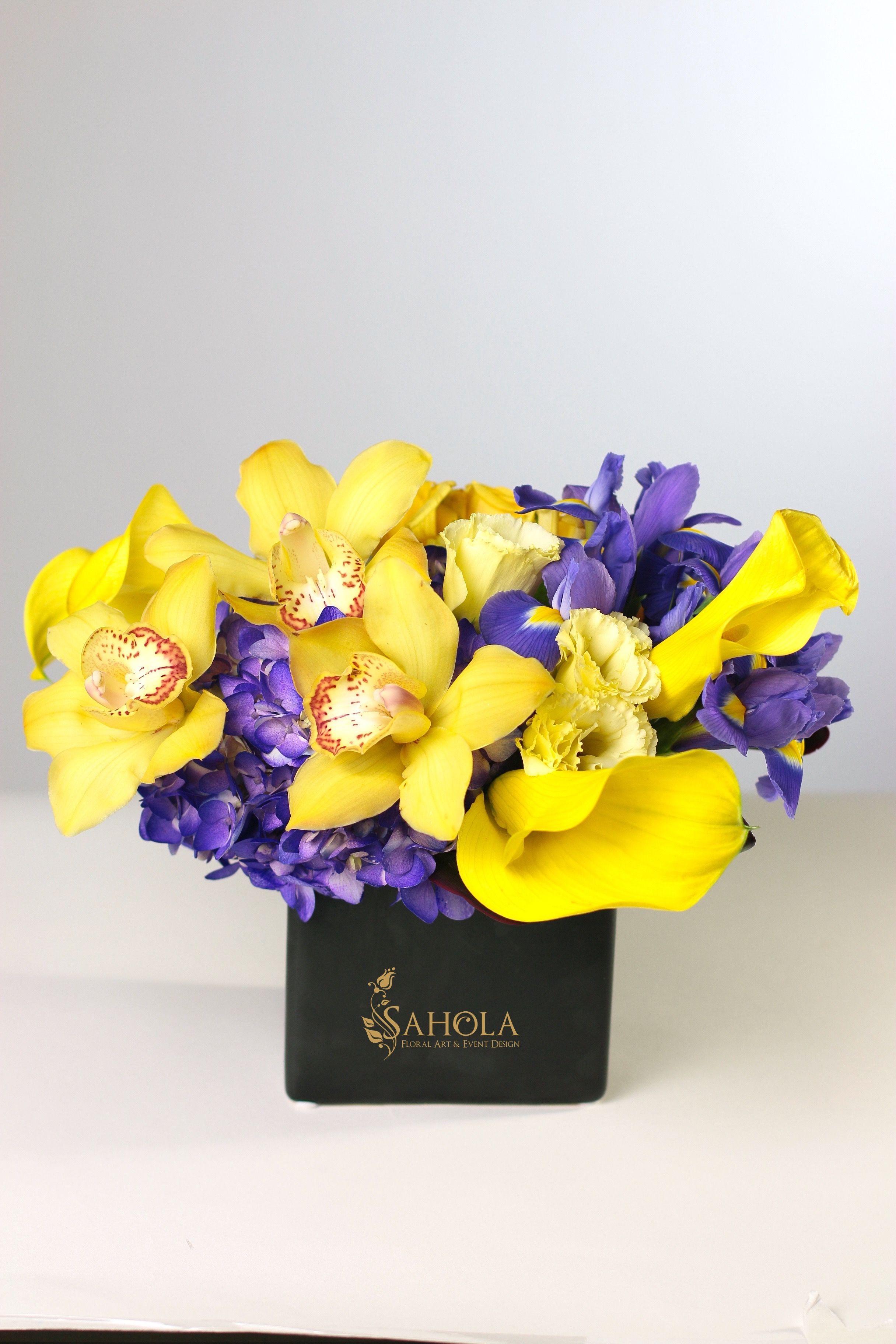 Modern flower arrangement with purple hydrangea purple irises modern flower arrangement with purple hydrangea purple irises yellow izmirmasajfo