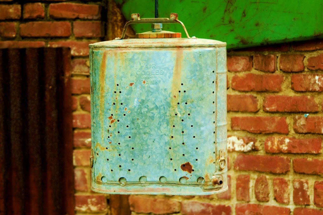 Hanging Industrial Pendant Light - Indian Back-Pack Sprayer Great Patina. $155.00, via Etsy.