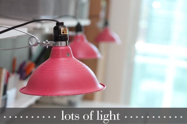 "craft room lighting by Damask Love:  clamp work lights ($8.50 each at Home Depot) + spray paint + Ecosmart 14 watt/60 watt equivalent ""daylight"" bulbs"
