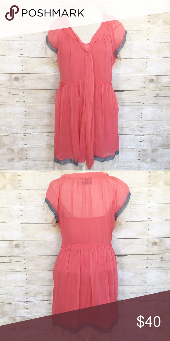 Juicy Couture 100% silk coral dress size 6 Juicy Couture 100% silk coral dress with cream and light blue accents and coral viscose lining. Adorable 1920's style. Side zipper. Size 6. Like new. Only worn once. Juicy Couture Dresses Midi