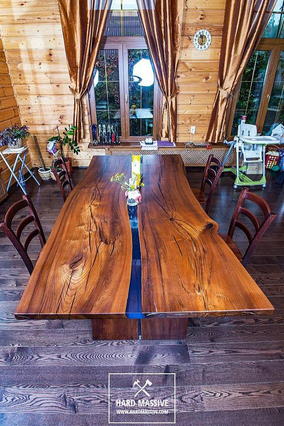 A Large Modern Dining Table Made Of Solid Wood With A Live