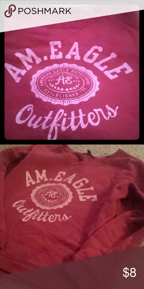 😍AE Sweater💞 This American Eagle sweatshirt is red with pink lettering. The sweatshirt has no stains and the only sign of wear is the cracked letters. Perfect for a chilly summer night!  **make me reasonable offers!!** American Eagle Outfitters Sweaters Crew & Scoop Necks