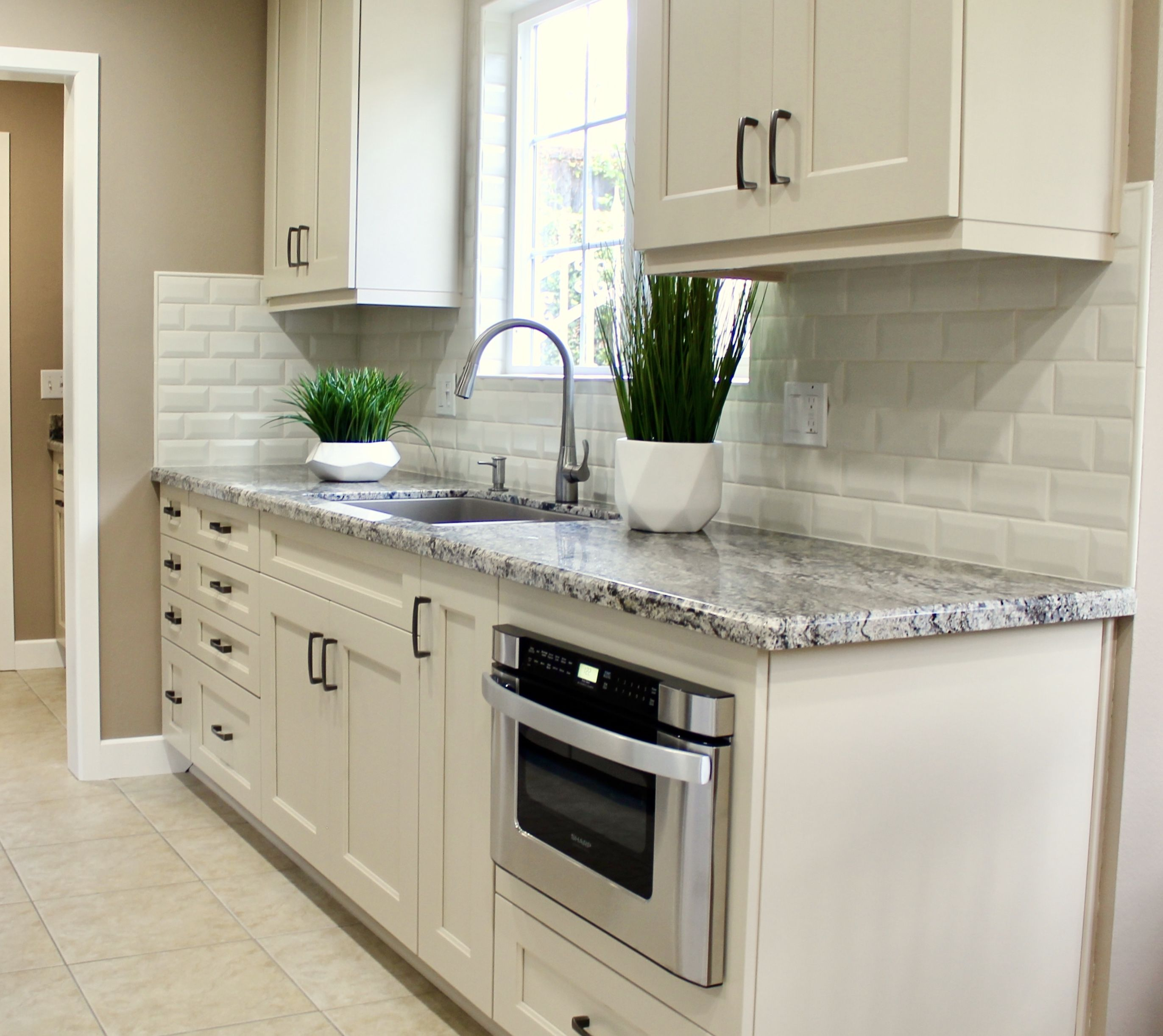 This La Mirada Kitchen Reface Looks Incredible The Updated Door Style And Subway Tile Backsplash Gave The Kitchen A Kitchen Refacing Kitchen Cabinetry Kitchen