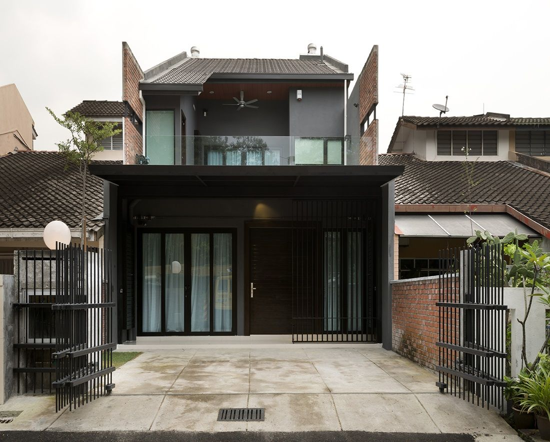 Modern contemporary transformation to a single storey terrace house in TTDI  by DRTAN LM Architect