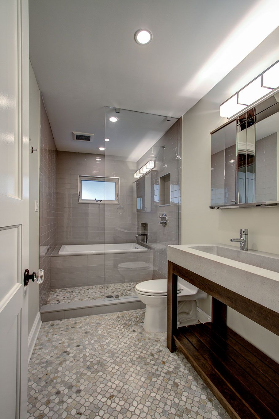 Guest Bathroom With Tub Enclosed Within Glassed In Shower Space. Brownstone  Renovation In Park