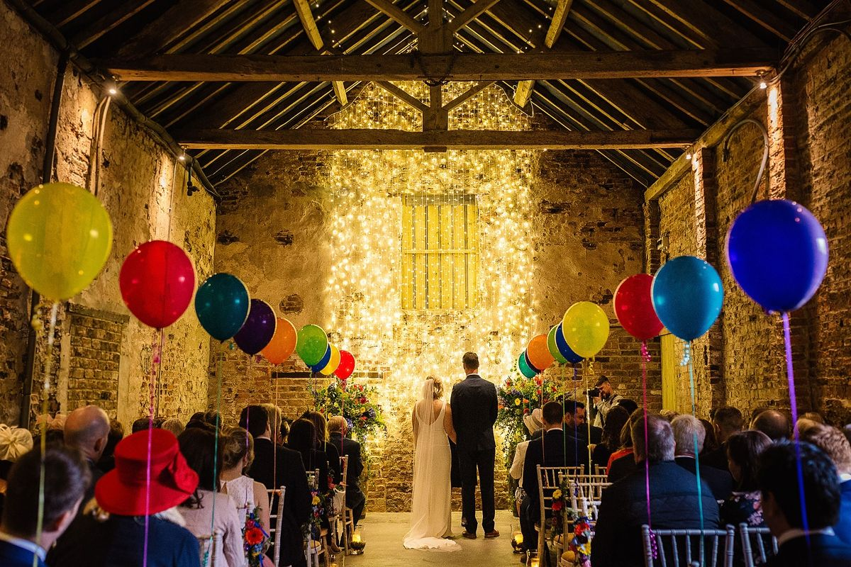 Barn wedding with fairy lights  Colourful Balloons and Fairy Lights for a Quirky Yorkshire Barn