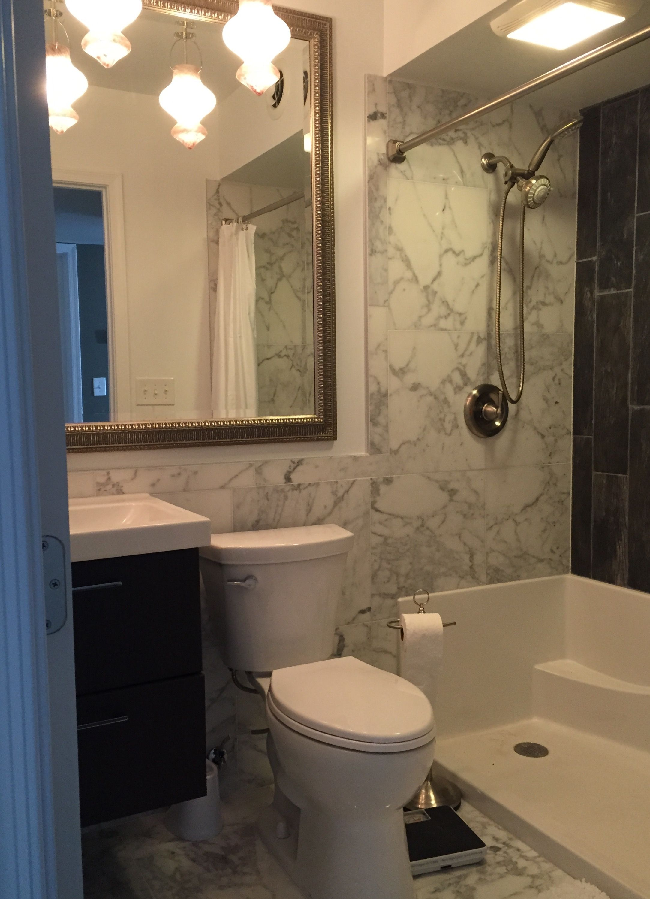 Small Guest Bathroom With White Marble Tile