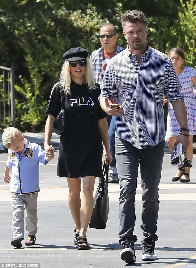 16c82b1bb At your service! Josh Duhamel escorts wife Fergie and son to church ...