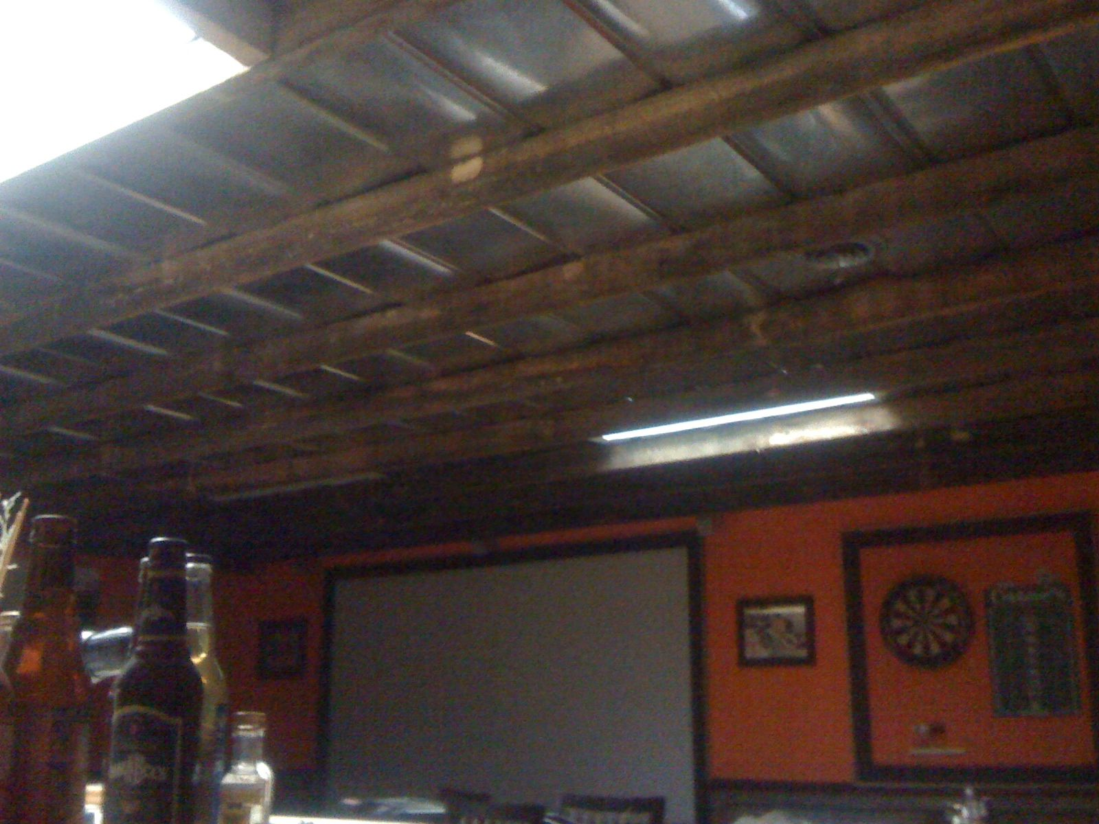5v metal roofing screwed to the ceiling then 2x4 rough