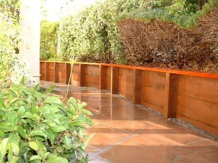 Pressure Treated Retaining Wall With Redwood Cap Wood Retaining
