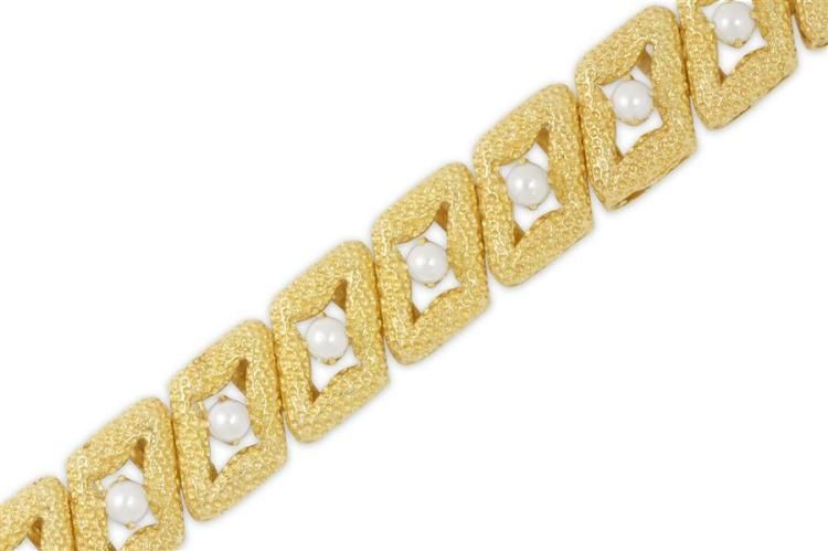 """<b>14kt Yellow Gold and Cultured Pearl Lady's Bracelet, L. 7""""</b> <br /> Textured design bracelet set with approx. 14 cultured pearls measuring approx. 4.0-4.1mm each.  Push-clasp with safety bar.  Stamped """"14K"""".  Weighing approx. 45.50 grams."""